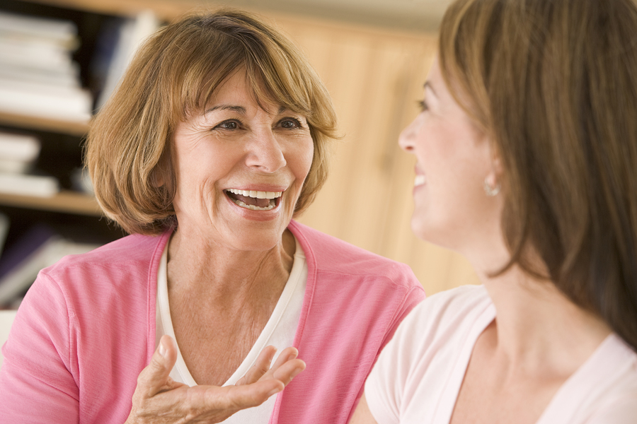 Senior woman having discussion at home with daughter