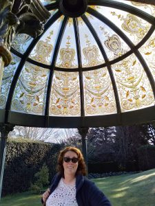 Suzie Linton smiling. She is standing under the cupola at Larnach Castle Dunedin - August 2021